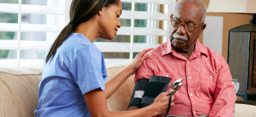 Nurse taking Blood Pressure of Old Man
