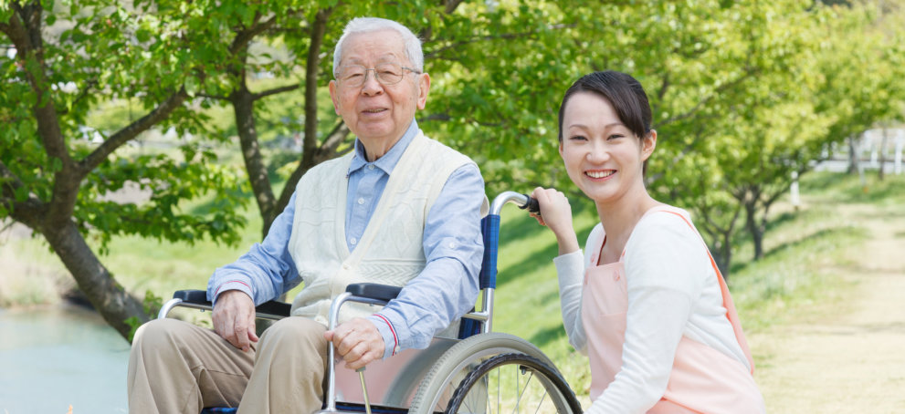 Care Taker and Old Man in a Wheelchair